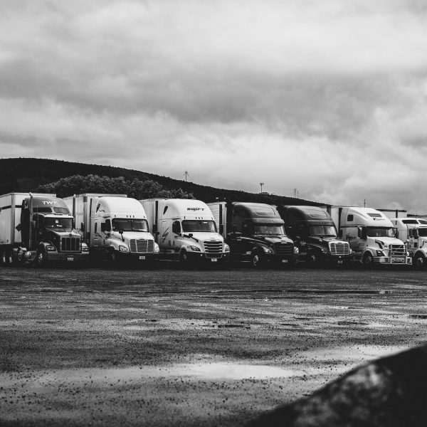 parked-trucks-under-clouds-2348359